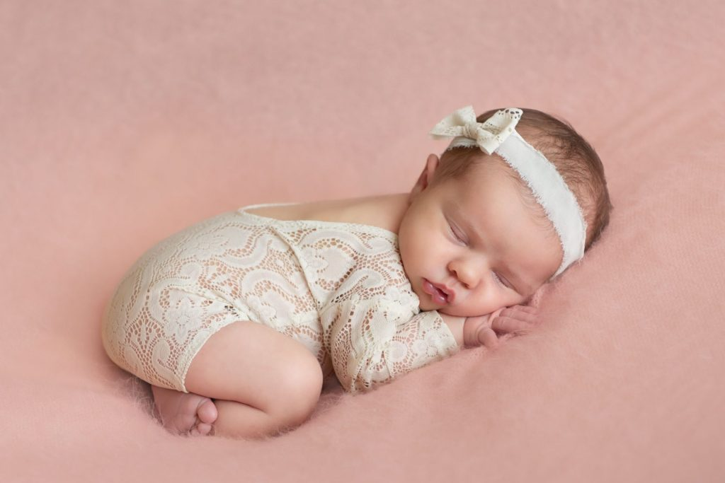 Little newborn from Coon Rapids during her photography session in Maple Grove. Newborn outfits make for an adorable look.