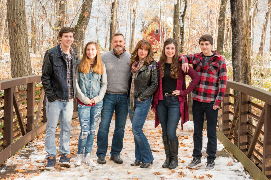 Family with teens during family photography winter session in Rogers, mn.