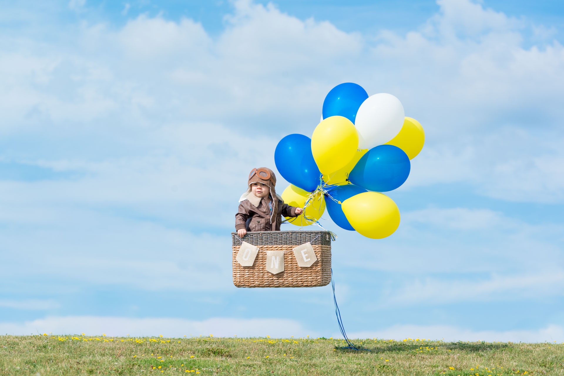One year photo shoot of little aviator and hot air balloon in Maple Grove by Addie Lane Studios