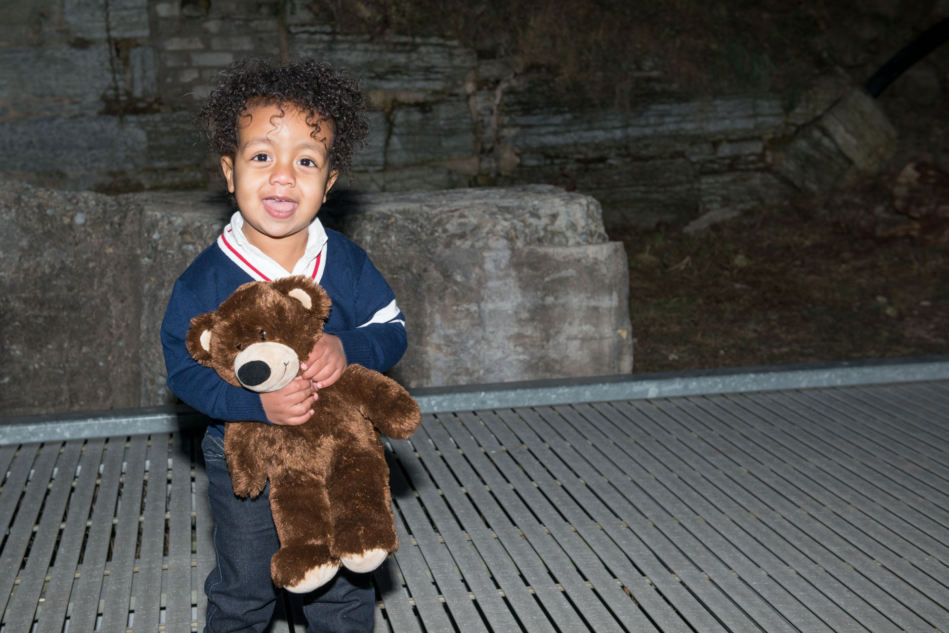 Little boy and his teddy bear are inseparable during their family photo shoot and baby photography in Minneapolis