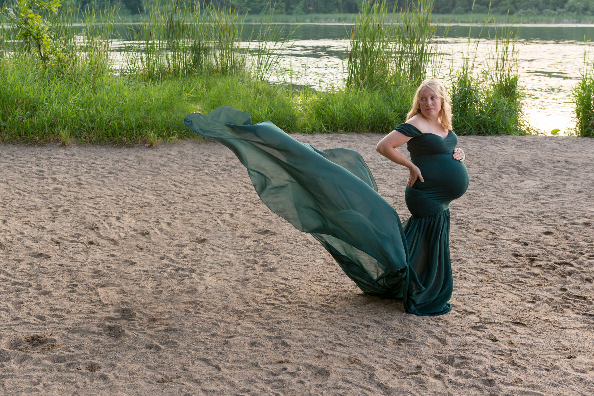 Maternity portrait session on the beach in gown with flowing train from Addie Lane Studios' client closet