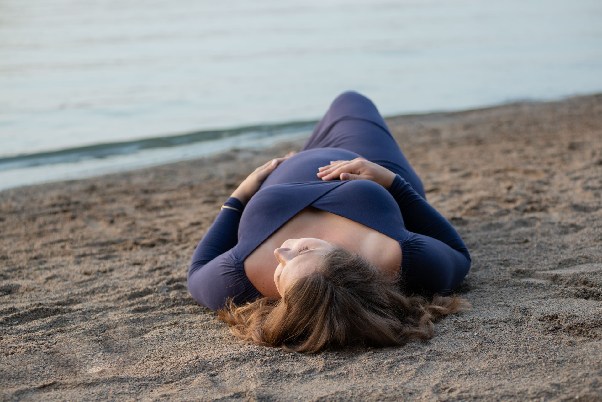 Maternity photo session on beach wearing gown from Addie Lane Studios' client closet. Plymouth, MN