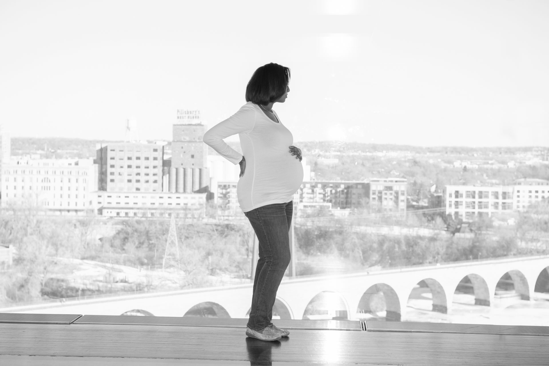 Maternity portrait session in the yellow room at the Guthrie Theatre in Minneapolis. Photo taken by Addie Lane Studios