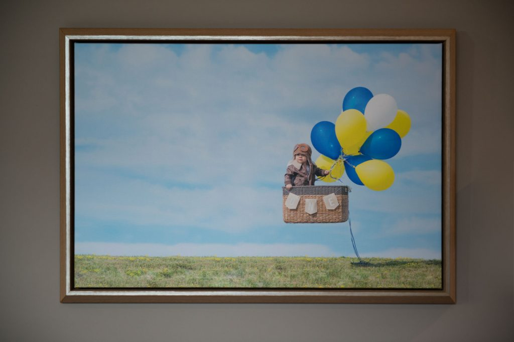 Framed canvas created from a children's birthday photo session with a hot air balloon and aviator theme