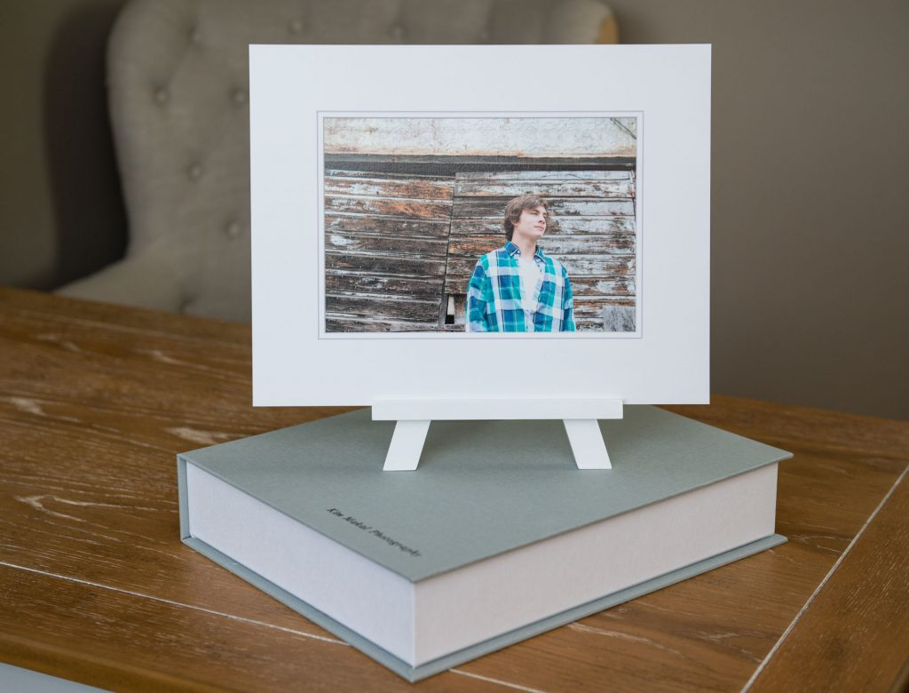 Linen keepsake folio box to store your printed images and a matted print on an easel
