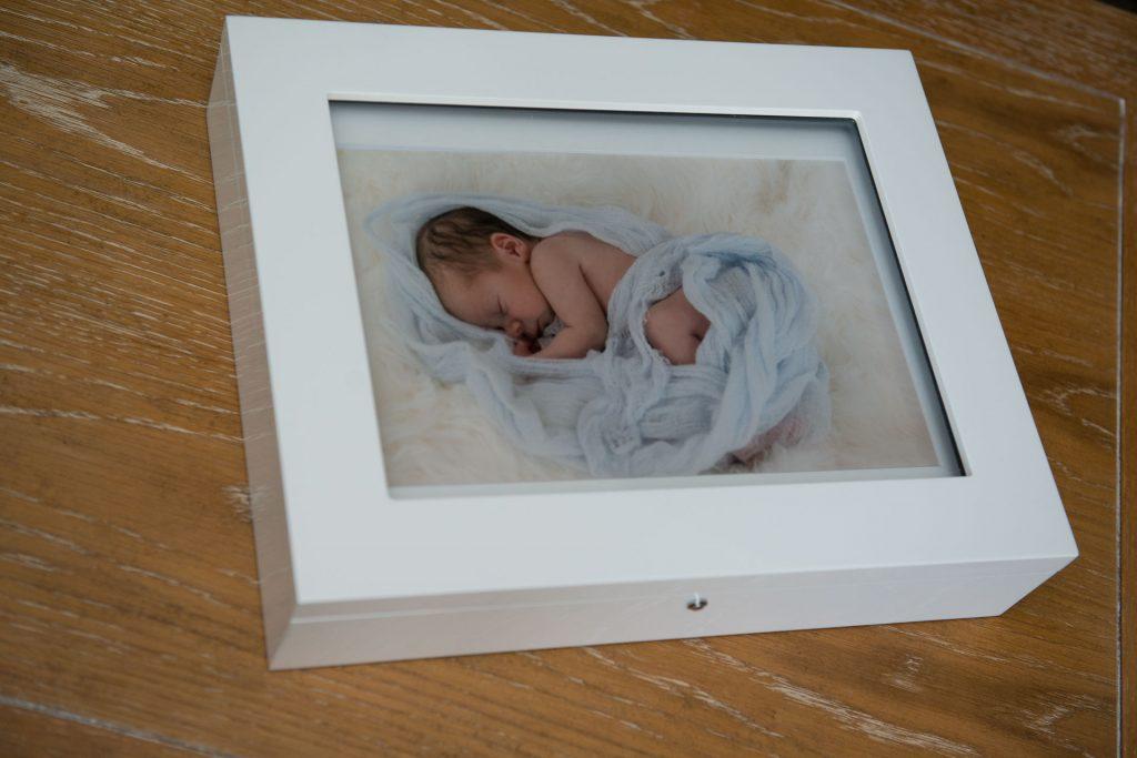 Wooden keepsake folio box and mounted prints showcase this newborn photography session