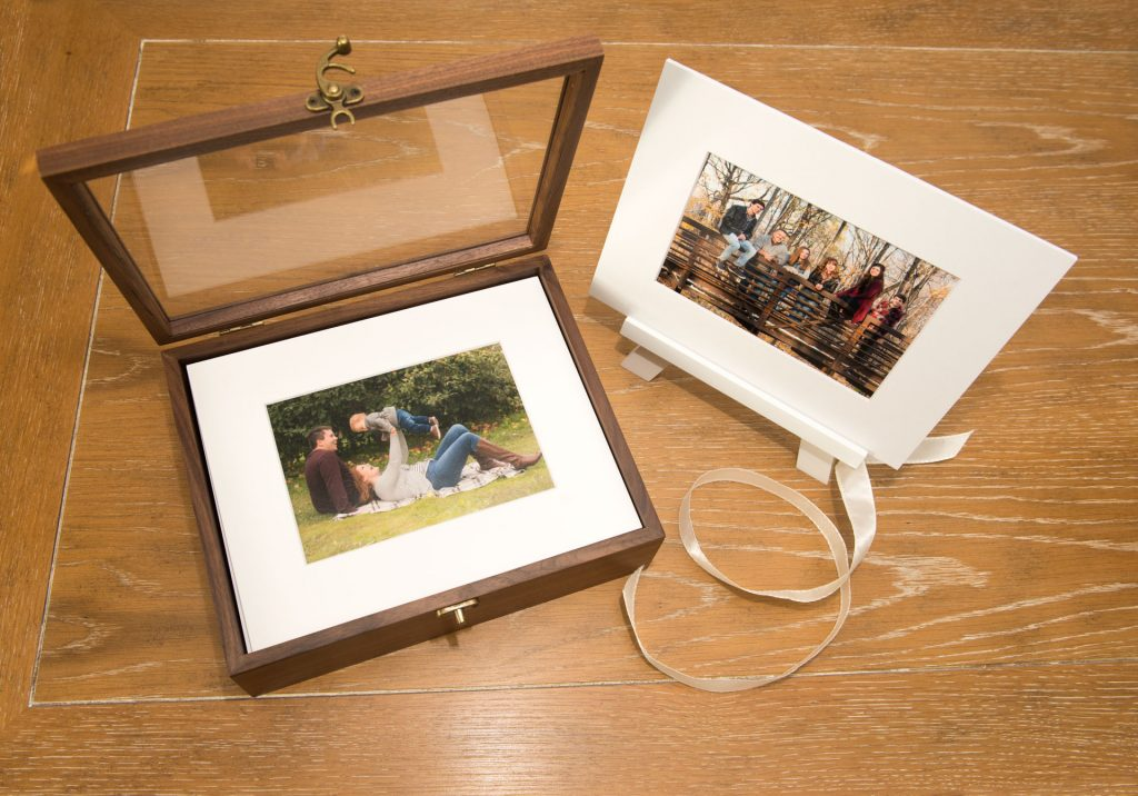 walnut keepsake folio box and matted print show some of the products available from these family photo sessions