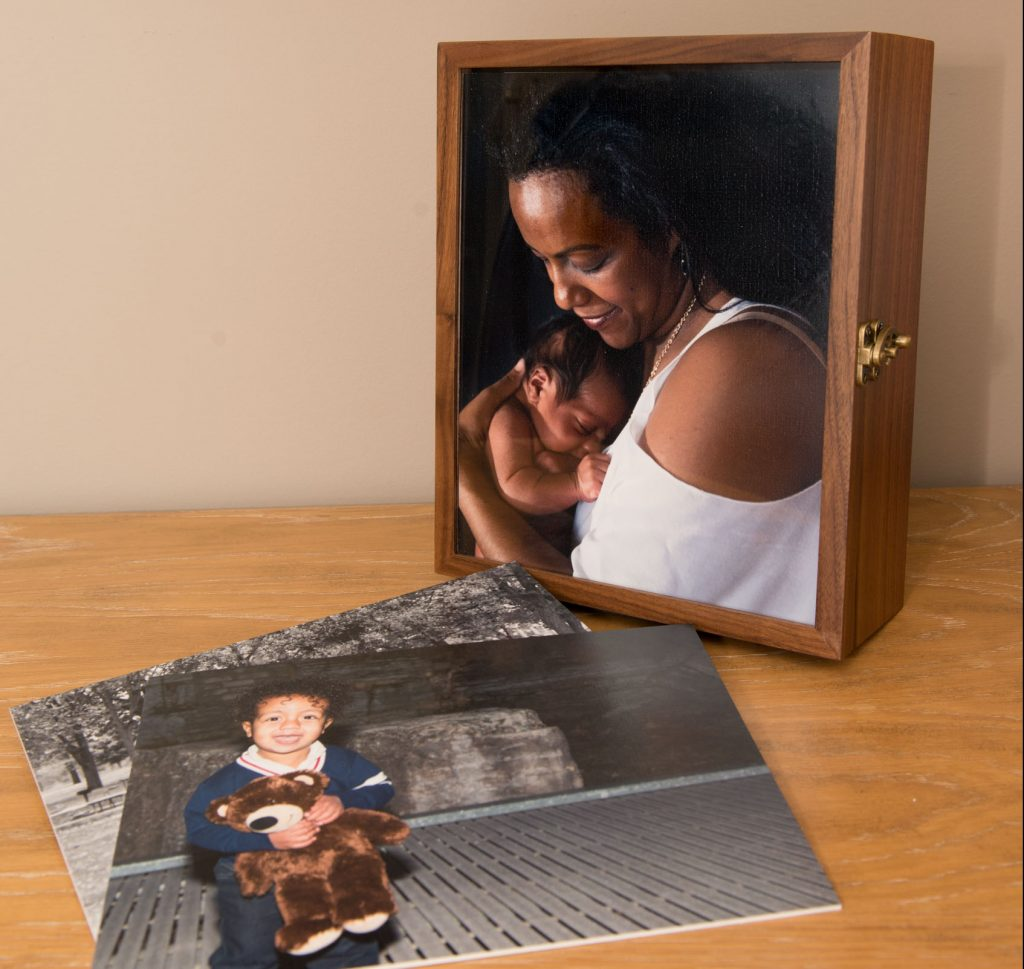 walnut keepsake folio box and mounted prints show some of the products available for this family from their newborn and family photography sessions